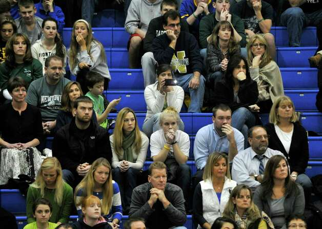 Spectators react during a moment of silence in the pre-game ceremony of Nighthawk's game against Masuk on Wednesday, Dec. 19, 2012. Wednesday's basketball game was the first sporting event since the Sandy Hook Elementary School shooting. Photo: Jason Rearick / The News-Times