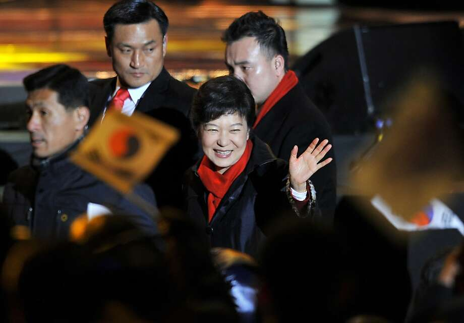 South Korea's president-elect Park Geun-Hye waves to supporters as she arrives to deliver a victory speech on a stage in the centre of Seoul on December 19, 2012.   South Korea elected its first female president on December 19, handing a slim but historic victory to conservative ruling party candidate Park Geun-Hye, daughter of the country's former military ruler.  AFP PHOTO / JUNG YEON-JEJUNG YEON-JE/AFP/Getty Images Photo: Jung Yeon-je, AFP/Getty Images