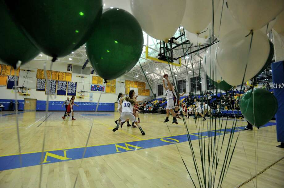 Twenty-six balloons are displayed during the Nighthawk's game against Masuk on Wednesday, Dec. 19, 2012. Wednesday's basketball game was the first sporting event since the Sandy Hook Elementary School shooting. Photo: Jason Rearick / The News-Times