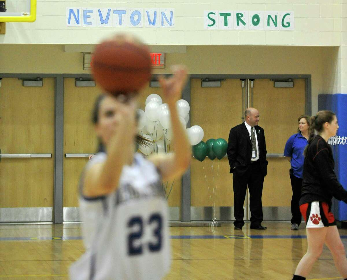 Newtown's Bridget Power shoots during warm ups before the Nighthawk's game against Masuk on Wednesday, Dec. 19, 2012. Wednesday's basketball game was the first sporting event since the Sandy Hook Elementary School shooting.