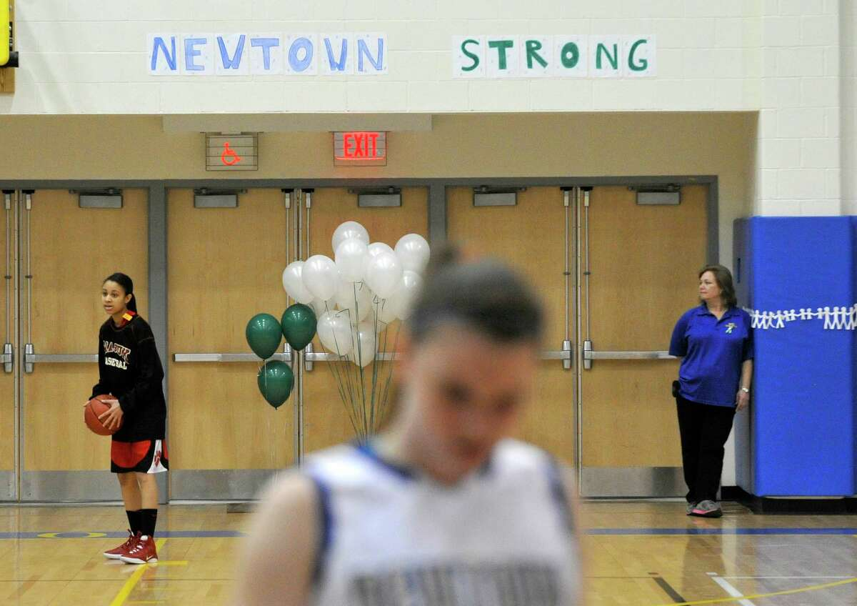 Twenty-six balloons are displayed during warm ups before the Nighthawk's game against Masuk on Wednesday, Dec. 19, 2012. Wednesday's basketball game was the first sporting event since the Sandy Hook Elementary School shooting.