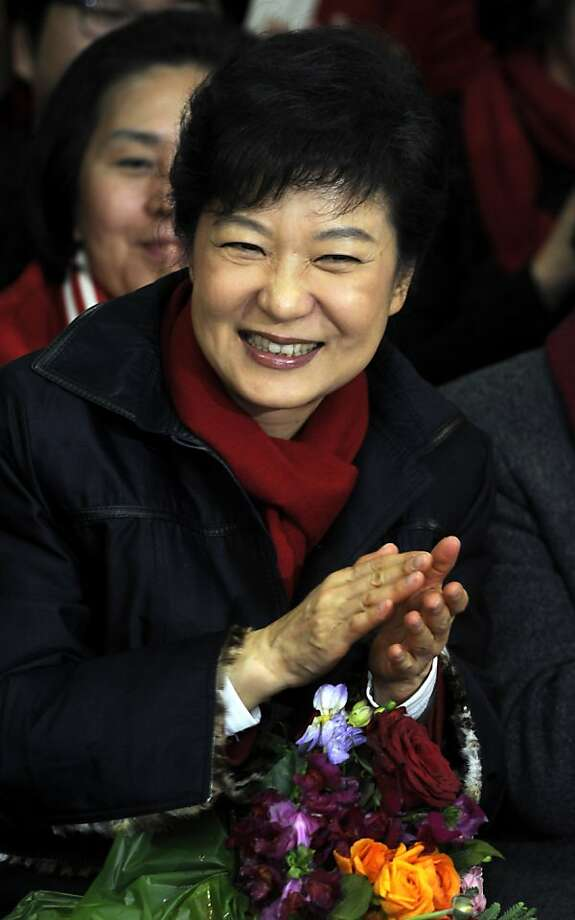 SEOUL, SOUTH KOREA - DECEMBER 19:  South Korean President-elect Park Geun-Hye, of the Ruling Saenuri Party celebrates with her party members during their applause after she is declared the winner of the presidential elections on December 19, 2012 in Seoul, South Korea. Park, daughter of former president Park Chung-Hee, becomes the first female president of South Korea.  (Photo by Song Kyung-Seok-pool/Getty Images) Photo: Pool, Getty Images