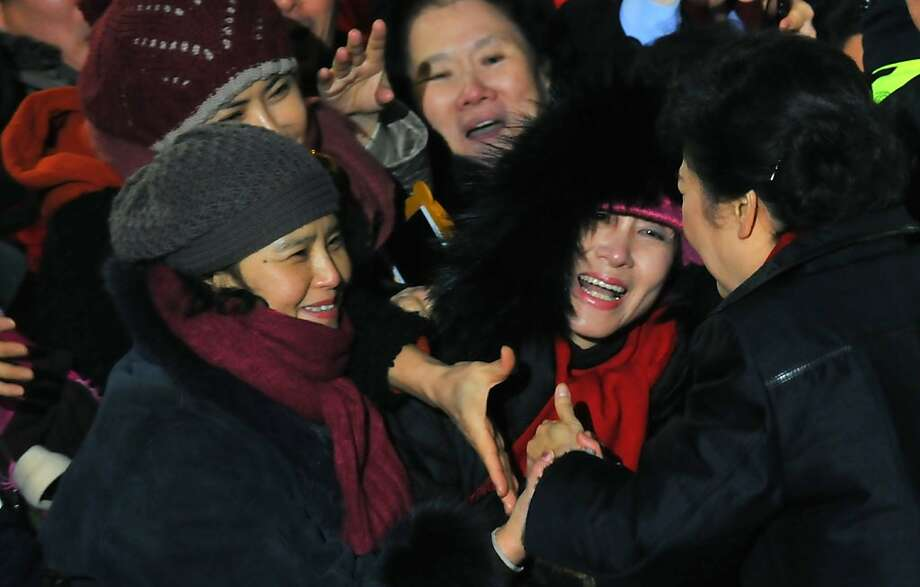 South Korea's presidential candidate Park Geun-Hye (R) of the ruling New Frontier Party, right, meets with the supporters in front of her house before leaving for the victory speech at party's headquarter in Seoul on December, 19. 2012.  South Korea appeared to have elected its first female president on December 19, as national TV predicted a clear victory for conservative Park Geun-Hye, daughter of the country's former dictator.AFP PHOTO / CHOI WON SUKCHOI WON SUK/AFP/Getty Images Photo: Choi Won Suk, AFP/Getty Images