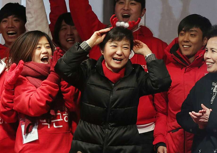 South Korea's presidential candidate Park Geun-hye of ruling Saenuri Party wears a reindeer headband during her presidential election campaign in Seoul, South Korea, Tuesday, Dec. 18, 2012. South Korea's presidential election is scheduled for Dec. 19. (AP Photo/Yonhap. Lee Ji-eun)  KOREA OUT Photo: Lee Ji-eun, Associated Press