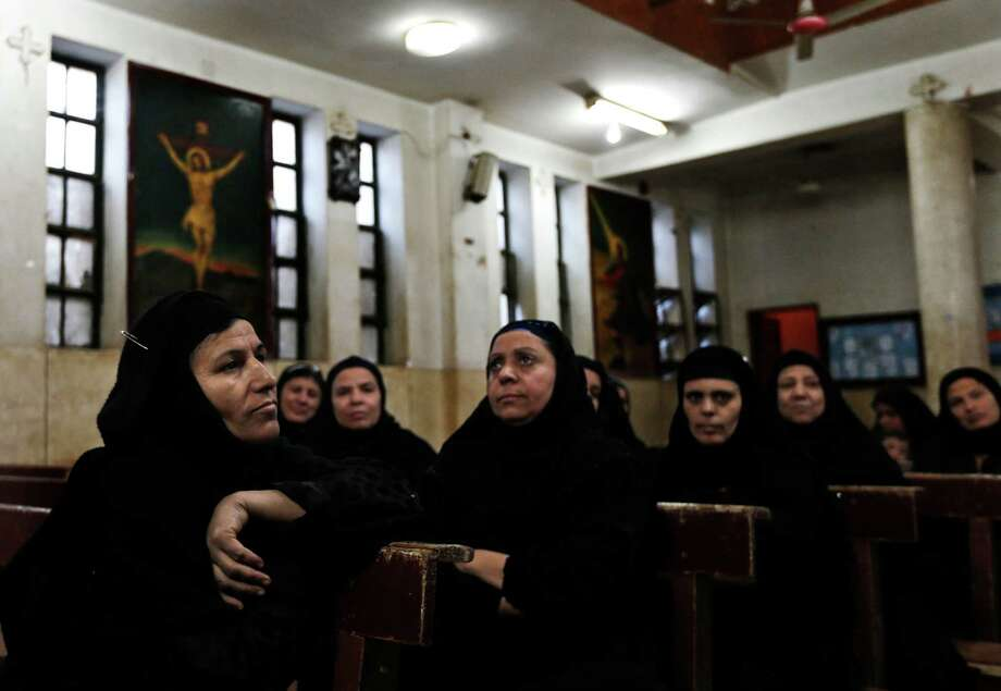 Christian women attend a class Tuesday in a church near Assiut in Egypt, where Christians are worried about the future under empowered Muslim conservatives. Photo: Petr David Josek, STF / AP