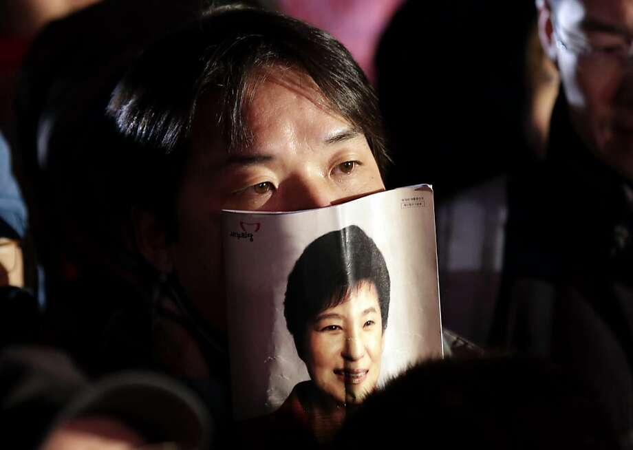 A supporter listens to a speech by South Korean presidential candidate Park Geun-hye of the ruling Saenuri Party during her campaign rally in Seoul, South Korea, Tuesday, Dec. 18, 2012. South Korea's presidential election is scheduled for Dec. 19. (AP Photo/Lee Jin-man) Photo: Lee Jin-man, Associated Press