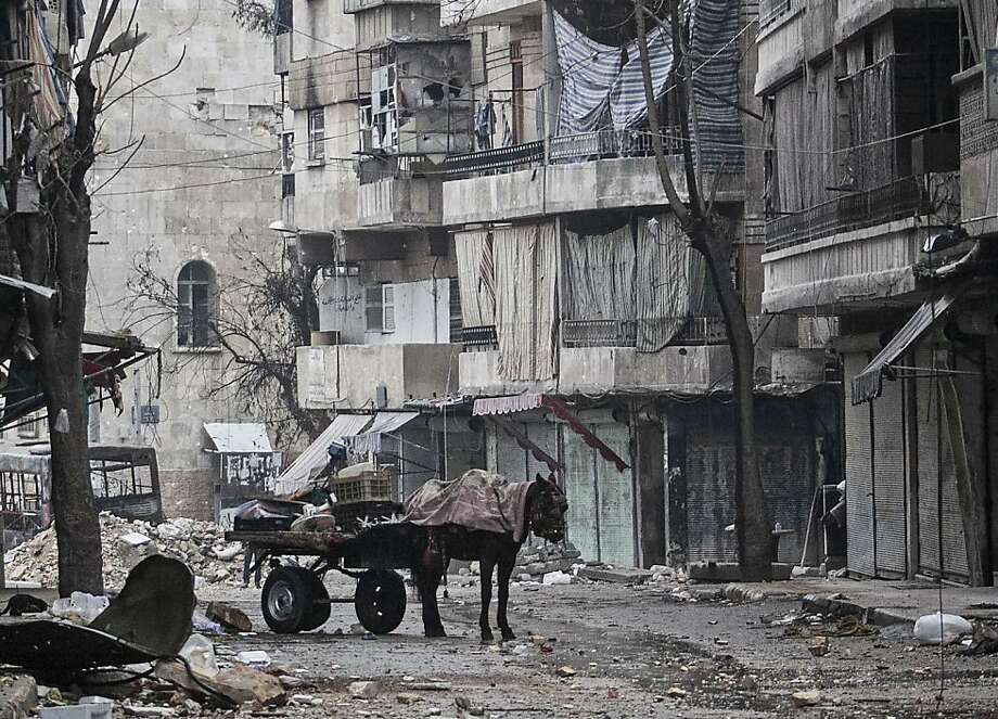 This Monday, Dec. 17, 2012 photo, shows damaged buildings due to heavy clashes between Free Syrian Army fighters and government forces in the Karmal Jabl neighborhood in Aleppo, Syria. (AP Photo/Narciso Contreras) Photo: Narciso Contreras, Associated Press