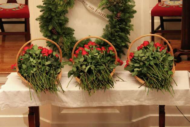 Three baskets of roses that will be delivered to Newtown, Conn. as condolences from the town of Darien. Dec. 19, 2012. Photo: Megan Davis