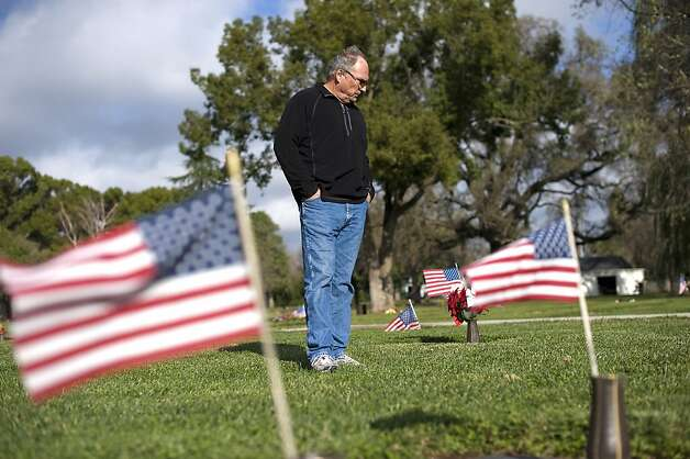 Kale Alderson visits the grave of his father John Alderson, a veteran of World War 2 who passed away in September before receiving his VA benefits, at Glen Oaks Memorial Park in Chico, CA Monday December 17th, 2012. Photo: Michael Short