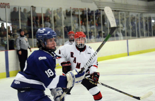 New Canaan's Peter Reinhardt (9) on the ice during the boys ice hockey game against Darien at the Darien Ice Rink on Wednesday, Dec. 19, 2012. Photo: Amy Mortensen / Connecticut Post Freelance