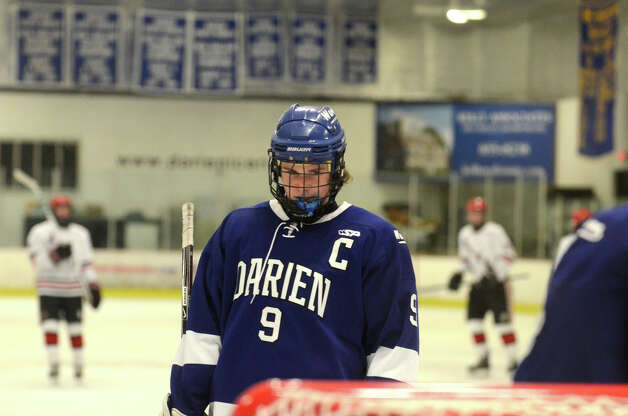Darien's Dana Wensberg (9) on the ice during the boys ice hockey game against New Canaan at the Darien Ice Rink on Wednesday, Dec. 19, 2012. Photo: Amy Mortensen / Connecticut Post Freelance