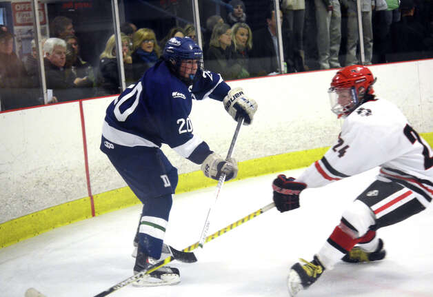 Darien's Trent Bergin (2) defends during the boys ice hockey game against New Canaan at the Darien Ice Rink on Wednesday, Dec. 19, 2012. Photo: Amy Mortensen / Connecticut Post Freelance