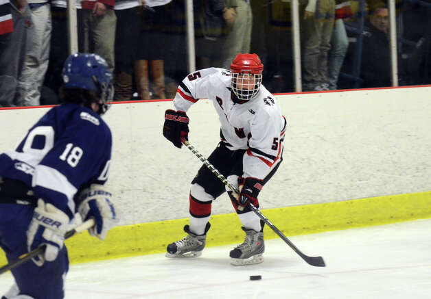 New Canaan's Davis Bruch (5) controls the puck during the boys ice hockey game against Darien at the Darien Ice Rink on Wednesday, Dec. 19, 2012. Photo: Amy Mortensen / Connecticut Post Freelance