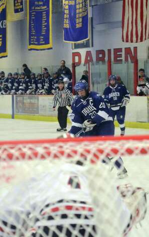 Darien's Trent Bergin (20) takes a shot on goal during the boys ice hockey game against New Canaan at the Darien Ice Rink on Wednesday, Dec. 19, 2012. Photo: Amy Mortensen / Connecticut Post Freelance