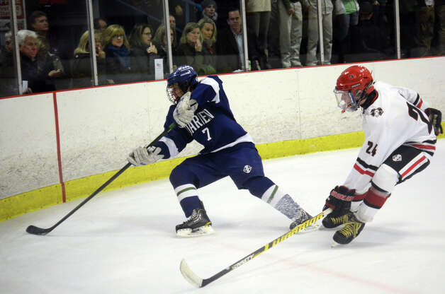 Darien's Jack Knowlton (7) controls the puck as New Canaan's Trent Nader (24) defends during the boys ice hockey game at the Darien Ice Rink on Wednesday, Dec. 19, 2012. Photo: Amy Mortensen / Connecticut Post Freelance