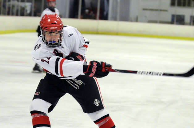 New Canaan's Patrick Hompe (22) takes a shot during the boys ice hockey game against Darien at the Darien Ice Rink on Wednesday, Dec. 19, 2012. Photo: Amy Mortensen / Connecticut Post Freelance