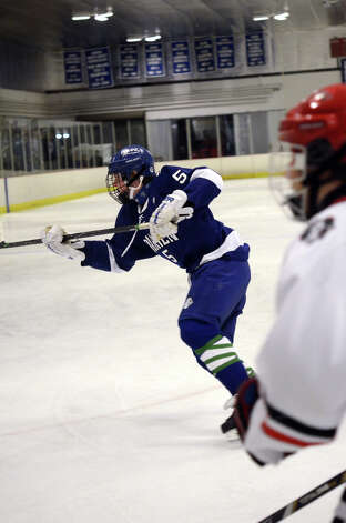 Darien's Owen Koorbusch (5) passes the puck during the boys ice hockey game against New Canaan at the Darien Ice Rink on Wednesday, Dec. 19, 2012. Photo: Amy Mortensen / Connecticut Post Freelance