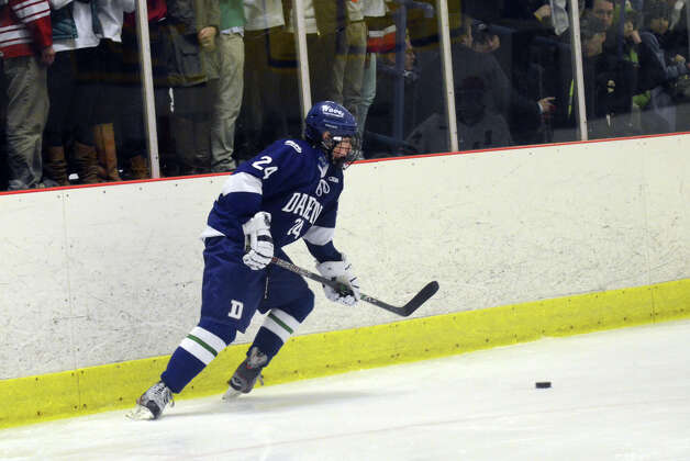 Darien's Dillon Fitzpatrick (24) controls the puck during the boys ice hockey game against New Canaan at the Darien Ice Rink on Wednesday, Dec. 19, 2012. Photo: Amy Mortensen / Connecticut Post Freelance