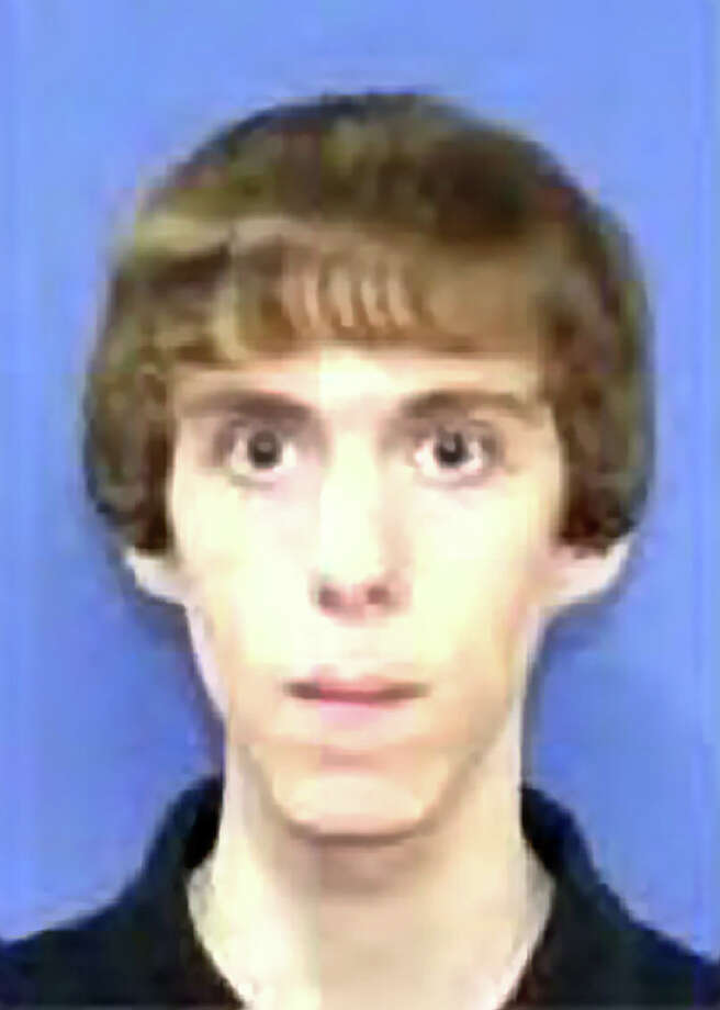 During his shooting spree, Adam Lanza wore body armor, black clothing and wielded a Bushmaster and Sig Sauer rifles, both equivalents of a military M-16. (Photo by NBC News) Photo: Uncredited, AP Photo/NBC News / AP2012 Associated Press
