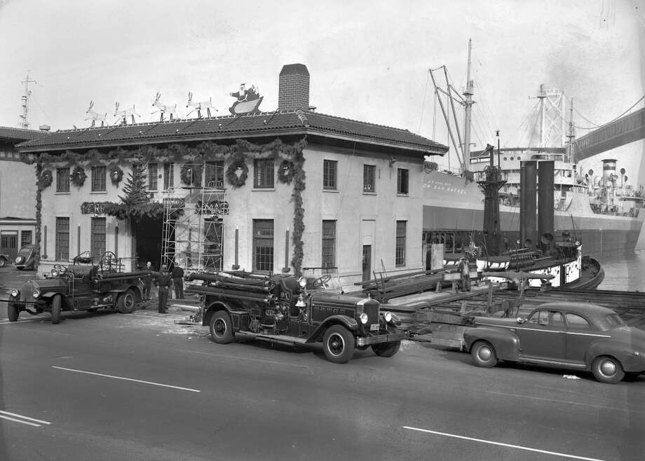 This is Station 35, which is still active along the Embarcadero at the end of Harrison Street. This slide has the best view of the fire trucks of the era, and note the fire boat in the back left. (Art Frisch / The Chronicle)