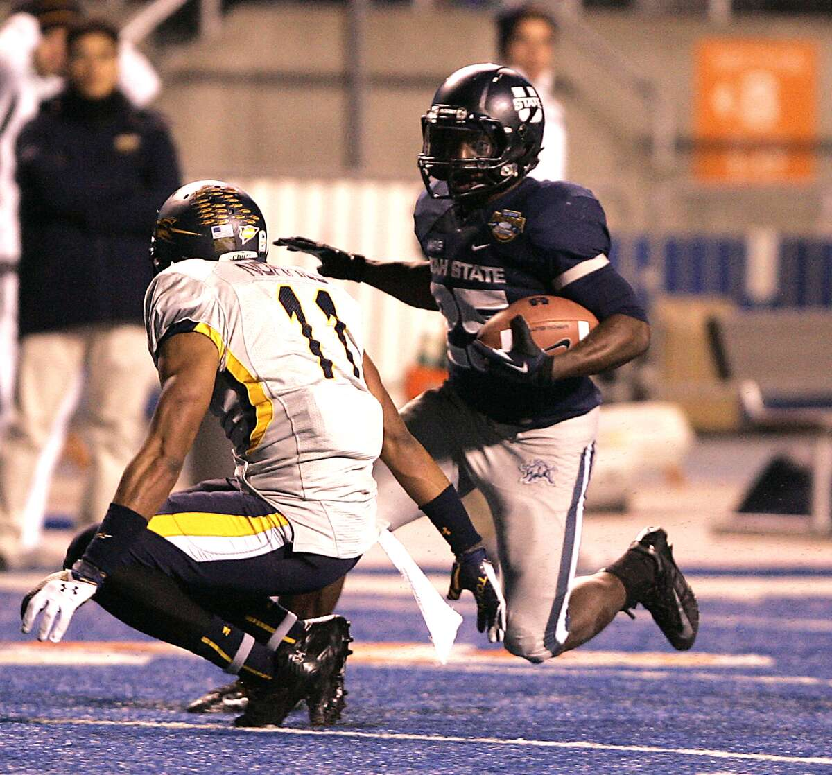 Famous Idaho Potato Bowl, Dec. 15: Utah State 41, Toledo 15; Bronco Stadium in Boise, Idaho; Payout: $325,000 PHOTO: Utah State's Kerwynn Williams (25) rushes for a first down against Toledo's Cheatham Norrils (11) during the second half of the Famous Idaho Potato Bowl.