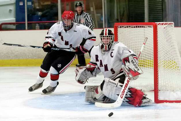New Canaan high school goalie Christopher Koennecke and defenseman John McMahon watch as a shot goes wide in a boys ice hockey game against Darien high school played at the Darien Ice Rink, Darien CT on Wednesday, December 19th, 2012 Photo: Mark Conrad / Stamford Advocate Freelance