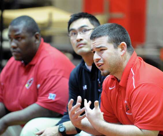 Greenwich wrestling coach George Albano, right, during boys high school wrestling match against Wilton High School at Greenwich High School, Wednesday night, Dec. 19, 2012. Photo: Bob Luckey / Greenwich Time