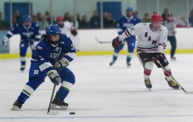 Darien high school's Thomas Watters moves the puck up ice in a boys ice hockey game against New Canaan high school played at the Darien Ice Rink, Darien CT on Wednesday, December 19th, 2012 Photo: Mark Conrad / Stamford Advocate Freelance