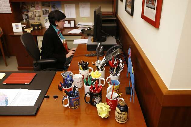 Mugs filled with different colored pens fill the desk of Katherine Feinstein, the presiding judge of San Francisco Superior Court, in her office on Wednesday, December 19, 2012 in San Francisco, Calif. Photo: Beck Diefenbach, Special To The Chronicle