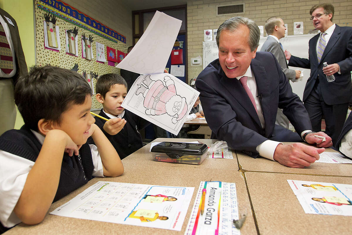 Lt. Gov. David Dewhurst visits with pupils after a news conference Wednesday at the Cathedral School of Saint Mary in Austin.