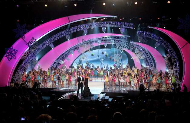 Contestants from 89 countries stand on the stage behind hosts Andy Cohen and Giuliana Rancic. Photo: AP