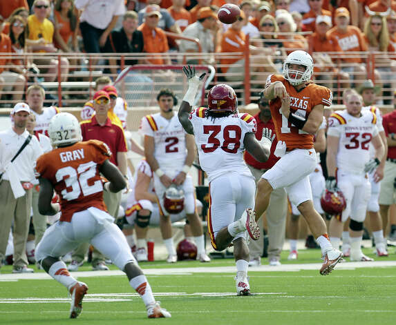 Texas Longhorns quarterback David Ash (14) throws over Iowa State's Roosevelt Maggitt (38) to Longhorn running back Johnathan Gray (32) in the first half at Darrell K. Royal Stadium in Austin on Saturday, Nov. 10, 2012. Photo: Kin Man Hui, San Antonio Express-News / © 2012 San Antonio Express-News