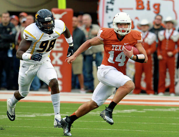 Longhorn quarterback David Ash sprints away from pressure for a gain in yards as Texas hosts West Virginia at Darrel K. Royal Texas Memorial Stadium in Austin on October 6, 2012. Photo: Tom Reel, San Antonio Express-News / ©2012 San Antono Express-News