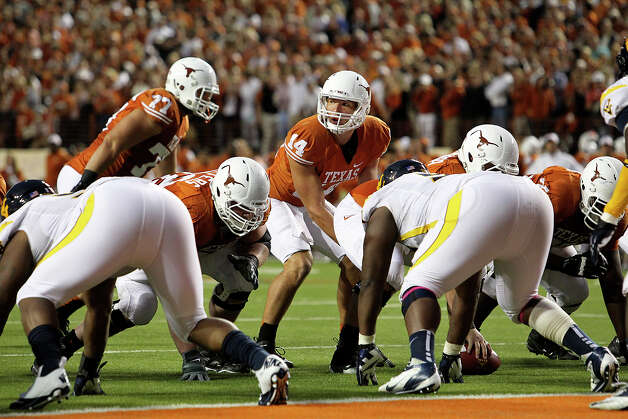 David Ash steps up to run the Longhorn offense as Texas hosts West Virginia at Darrel K. Royal Texas Memorial Stadium in Austin on October 6, 2012. Photo: Tom Reel, San Antonio Express-News / ©2012 San Antono Express-News