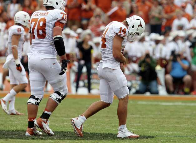Texas Longhorns quarterback David Ash (14) walks off the field after getting sacked by the Oklahoma Sooners in the second half at the Red River Rivalry at the Cotton Bowl in Dallas on Saturday, Oct. 13, 2012. He eventually left the game for good with an apparent injury. The Sooners defeated the Longhorns 63-21. Photo: Kin Man Hui, San Antonio Express-News / © 2012 San Antonio Express-News
