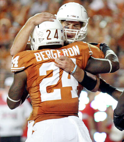 Texas Longhorns' Joe Bergeron (left) and teammate Texas Longhorns' David Ash celebrate after Bergeron scored a touchdown against the New Mexico Lobos during second half action Saturday Sept. 8, 2012 at Texas Memorial Stadium in Austin, Tx. The Longhorns won 45-0. Photo: Edward A. Ornelas, San Antonio Express-News / © 2012 San Antonio Express-News