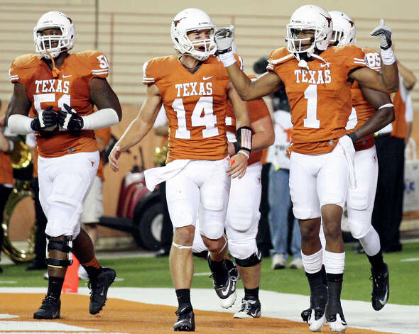 Texas Longhorns' Mike Davis (right) celebrates with teammate Texas Longhorns' David Ash and others after scoring a touchdown against the  New Mexico Lobos during first half action Saturday Sept. 8, 2012 at Texas Memorial Stadium in Austin, Tx. Photo: Edward A. Ornelas, San Antonio Express-News / © 2012 San Antonio Express-News