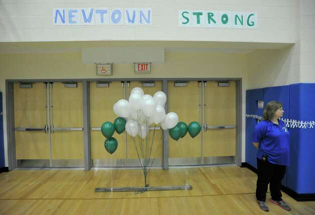 Twenty-six balloons are displayed during warm ups before the Nighthawk's game against Masuk on Wednesday, Dec. 19, 2012. Wednesday's basketball game was the first sporting event since the Sandy Hook Elementary School shooting. Photo: Jason Rearick / The News-Times