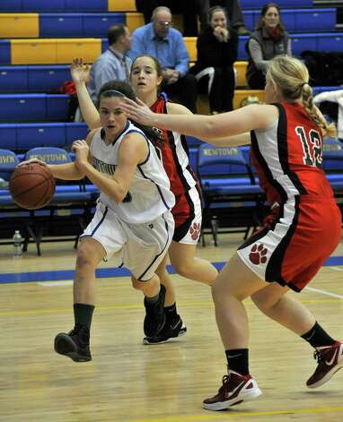 Newtown's Bridget Power(23) drives the baseline on Masuk's Paige Santee(13) during the Nighthawk's game against Masuk on Wednesday, Dec. 19, 2012. Wednesday's basketball game was the first sporting event since the Sandy Hook Elementary School shooting. Photo: Jason Rearick / The News-Times