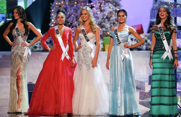 The final five contestants, from left, Miss Brazil, Gabriela Markus; Miss USA, Olivia Culpo; Miss Australia, Renae Ayris; Miss Philippines, Janine Tugonon; and Miss Venezuela, Irene Sofia Esser Quintero; stand together during the Miss Universe competition  in Las Vegas, Wednesday, Dec. 19, 2012. Photo: AP / SL