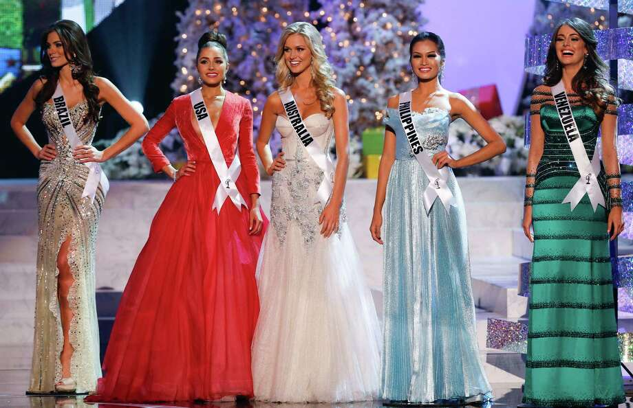 The final five contestants, from left, Miss Brazil, Gabriela Markus; Miss USA, Olivia Culpo; Miss Australia, Renae Ayris; Miss Philippines, Janine Tugonon; and Miss Venezuela, Irene Sofia Esser Quintero; stand together. Photo: AP