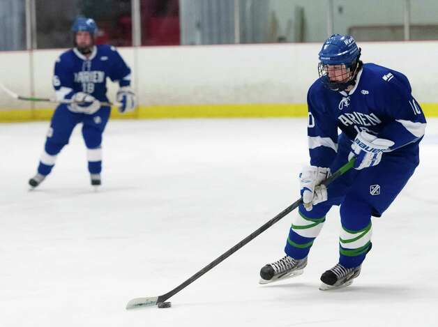 Darien high school's Jack Massie moves the puck up ice in a boys ice hockey game against New Canaan high school played at the Darien Ice Rink, Darien CT on Wednesday, December 19th, 2012 Photo: Mark Conrad / Stamford Advocate Freelance