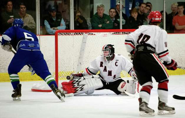 New Canaan high school goalie Christopher Koennecke makes a save on a shot by Darien high school's Owen Koorbusch in a boys ice hockey game played at the Darien Ice Rink, Darien CT on Wednesday, December 19th, 2012 Photo: Mark Conrad / Stamford Advocate Freelance