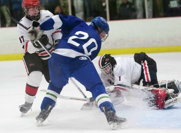 New Canaan high school vs. Darien high school in a boys ice hockey game played at the Darien Ice Rink, Darien CT on Wednesday, December 19th, 2012 Photo: Mark Conrad / Stamford Advocate Freelance