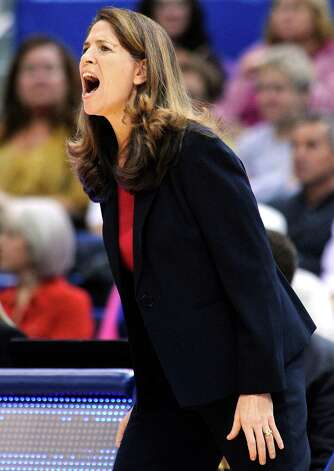 Oakland coach Beckie Francis reacts during the first half of her team's 97-25 loss to Connecticut in an NCAA college basketball game in Hartford, Conn., Wednesday, Dec. 19, 2012. (AP Photo/Fred Beckham) Photo: Fred Beckham, Associated Press / FR153656 AP