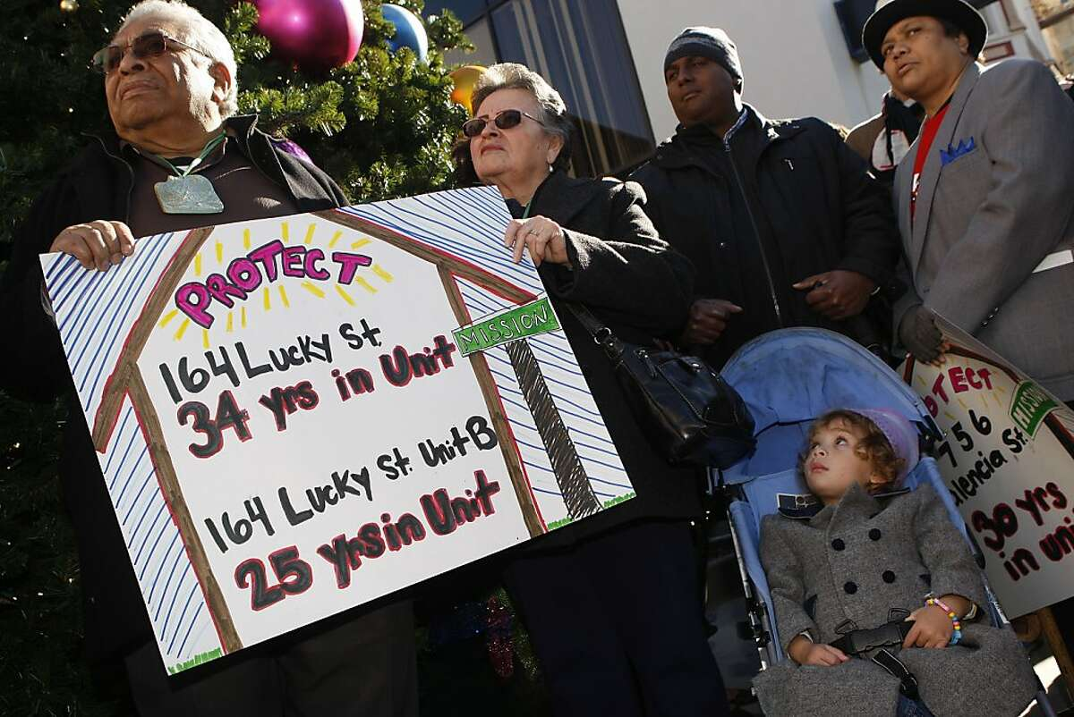 Left to right--Tenants Roberto Alfaro, and his neighbor Ana Gutierrez, James Thortnton and his two year old daughter Gabriella Thornton (in stroller), and past veteran Morningstar Vancil protest Ellis Act evictions they are undergoing in San Francisco, California, on Wednesday, December 19, 2012.