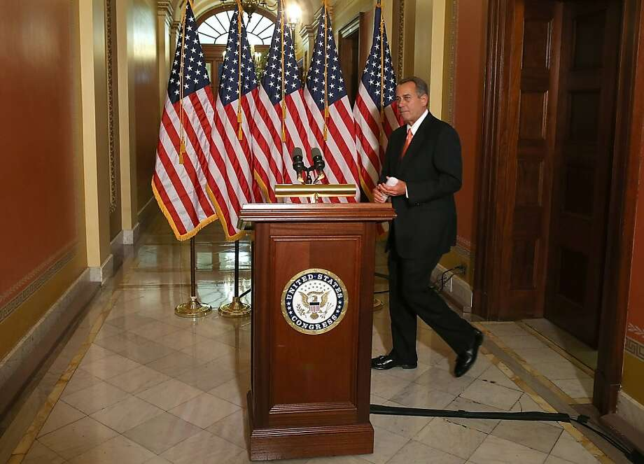House Speaker John Boehner prepares to make a statement about talks with the White House on tax and spending cuts. Photo: Mark Wilson, Getty Images