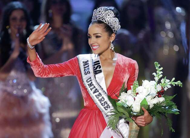 Miss USA, Olivia Culpo, waves to the crowd after being crowned as Miss Universe. Photo: AP