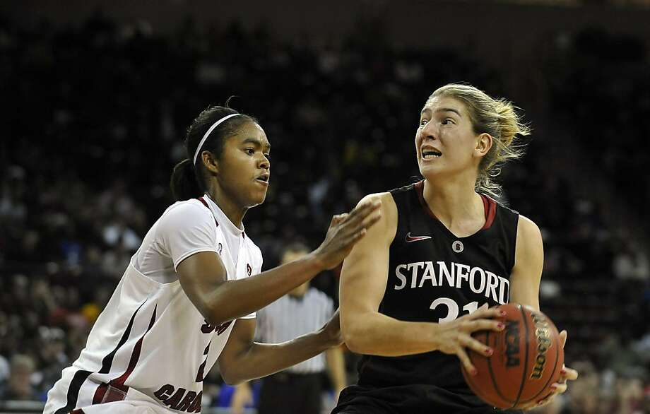 Stanford's Toni Kokenis (31) drives to the basket as South Carolina's Sancheon White (20) defends during the second half of an NCAA college basketball game on Wednesday, Dec. 19, 2012, in Columbia, S.C. Stanford won 53-49. (AP Photo/Rainier Ehrhardt) Photo: Rainier Ehrhardt, Associated Press