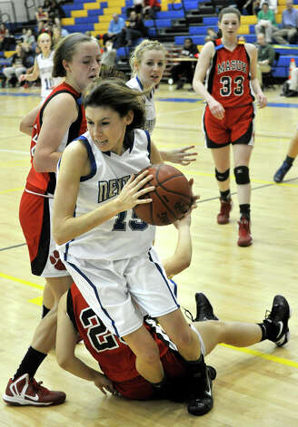 Masuk's Jenny Skoog falls on the leg of Erin Kenning, of Newtown, during the Nighthawk's game against Masuk at Newtown High School on Wednesday, Dec. 19, 2012. Wednesday's basketball game was the first sporting event in Newtown since the Sandy Hook Elementary School shooting. Newtown won, 64-44. Photo: Jason Rearick / The News-Times